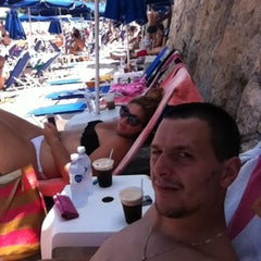 Photo taken at Almyra Beach Bar by Lewnidas I. on 7/6/2013