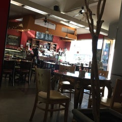 Photo taken at The Novel Cafe by Jon S. on 4/27/2015