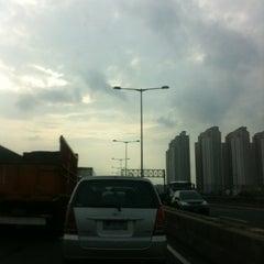 Photo taken at Jalan Tol Pelabuhan by Zamzami A. on 1/18/2013