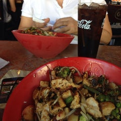 Photo taken at Genghis Grill by Fernanda R. on 9/22/2013