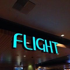 Photo taken at Flight Bar by Masashi S. on 6/20/2014