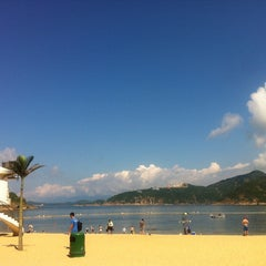 Photo taken at South Bay Beach 南灣泳灘 by Christine T. on 6/1/2013