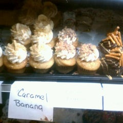 Photo taken at Indulgence Cupcakery by Rachel S. on 1/14/2012