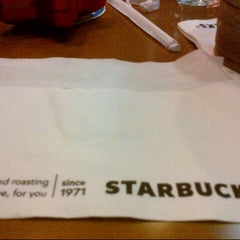 Photo taken at Starbucks by Siti S. on 12/19/2013