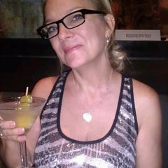 Photo taken at Tommy Bahama's Tropical Cafe by Michelle B. on 7/27/2013