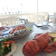 Photo taken at Tugboats Restaurant by Kazutoshi Y. on 7/3/2014