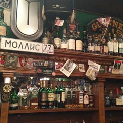 Photo taken at Mollie's Irish Pub by Alexander A. on 6/1/2013