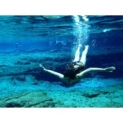 Photo taken at Ginnie Springs by Mint K. on 6/16/2014