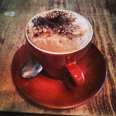 Photo taken at Café Olimpico by Cathy K. on 5/26/2013