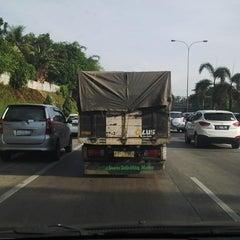 Photo taken at Jalan Tol Jakarta - Cikampek by Mutia R. on 12/24/2014