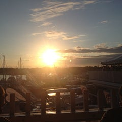 Photo taken at Tugboats Restaurant by Stacey C. on 8/9/2014
