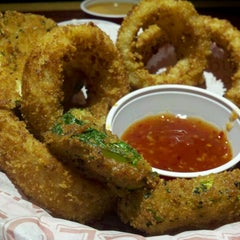 Photo taken at Red Robin Gourmet Burgers by Abigail C. on 12/1/2012