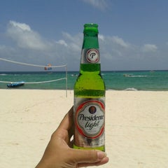Photo taken at Los Corales Beach by Julissa M. on 9/13/2014