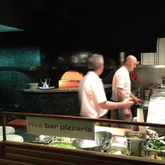 Photo taken at Riva Bar & Pizzeria by Ryan C. on 3/19/2013