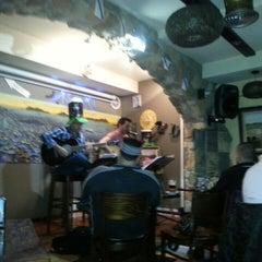 Photo taken at Café Tempo by J. A. on 3/15/2014