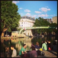 Photo taken at Canal Saint-Martin by Benoit D. on 6/22/2013