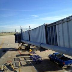 Photo taken at Gate B17 by Jimi Y. on 9/20/2012