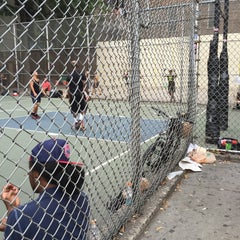 Photo taken at West 4th Street Courts (The Cage) by Stéphanie S. on 9/12/2015
