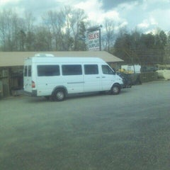 Photo taken at Delks Army Navy Surplus by Robin B. on 3/13/2012