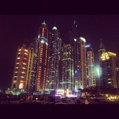 Photo taken at Dubai Marina Walk ممشى مرسى دبي by Chris W. on 7/28/2012