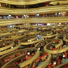 Photo taken at Marina Bay Sands Casino by MediaGet.com on 12/19/2011