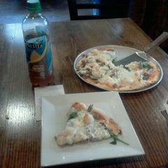 Photo taken at Bagby Pizza Co. by Isaac B. on 10/22/2011