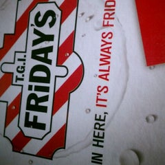Photo taken at TGI Fridays by Lolly S. on 1/1/2012