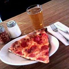 Photo taken at Howie's Artisan Pizza by Felipe B. on 10/18/2011