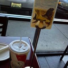 Photo taken at Viztango Cafe by Jon S. on 4/3/2012