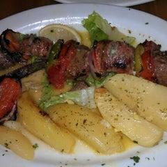 Photo taken at Avli Little Greek Tavern by Andrew G. on 10/1/2011