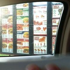 Photo taken at Rally's Hamburgers by Faith B. on 4/14/2012