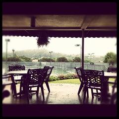 Photo taken at Courtyard Tennis Center by Tomoko J. on 5/8/2012