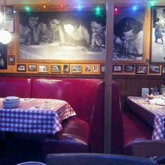 Photo taken at Buca di Beppo Italian Restaurant by Fabiana W. on 4/8/2012