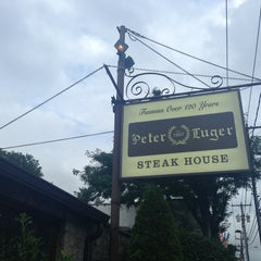 Photo taken at Peter Luger Steak House by Ana Y. on 7/13/2013