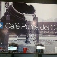 Photo taken at Café Punta del Cielo by Ricky O. on 7/16/2013
