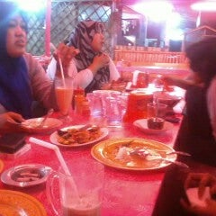 Photo taken at MJ Seafood by Rendra K. on 12/20/2012