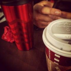 Photo taken at Starbucks by jc T. on 12/19/2013