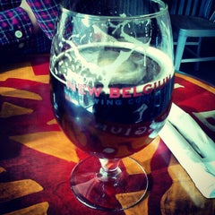 Photo taken at New Belgium Brewing Hub by Trevor D. on 12/17/2012