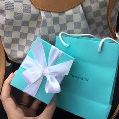 Photo taken at Tiffany & Co. by Elle W. on 11/28/2014