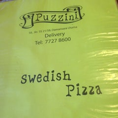 Photo taken at Puzzini Swedish Pizza by RAZZ MANN on 9/16/2013