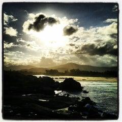 Photo taken at Praia da Ferrugem by Chay L. on 10/7/2013