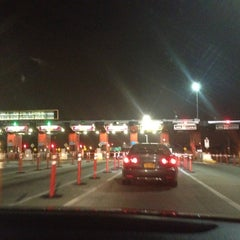 Photo taken at Throgs Neck Bridge Toll Plaza by Adriana Lynn on 7/15/2012
