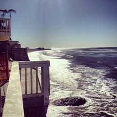 Photo taken at Isla Vista Beach by Erin J. on 4/9/2013