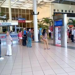 Photo taken at Aeropuerto Internacional del Cibao by Jose Luis M. on 10/12/2013