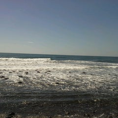 Photo taken at Playa El Zonte by Melissa P. on 1/2/2015