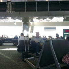 Photo taken at Gate A30 by Moe ♋. on 1/9/2013