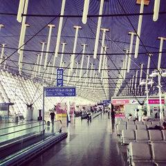 Photo taken at 上海浦东国际机场1号航站楼 T1 Shanghai Pudong Int'l Airport by Simón P. on 5/1/2013