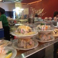 Photo taken at Sushi Train by Stephanie V. on 7/23/2014