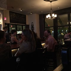 Photo taken at The Tangled Vine Wine Bar & Kitchen by Russ on 5/7/2015