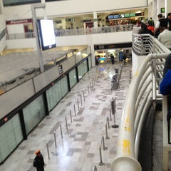 Photo taken at Terminal 1 by Fernando A. on 2/1/2013